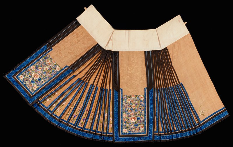 Embroidery on tan brocade, black and blue trim
