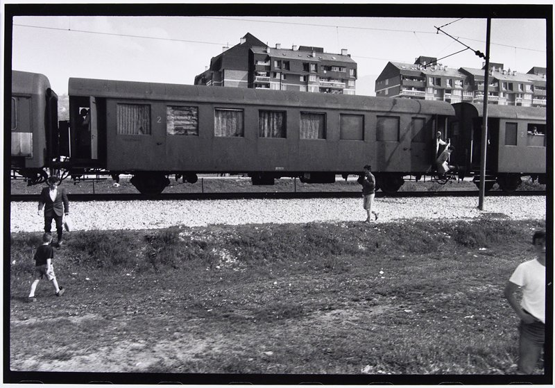woman getting off train
