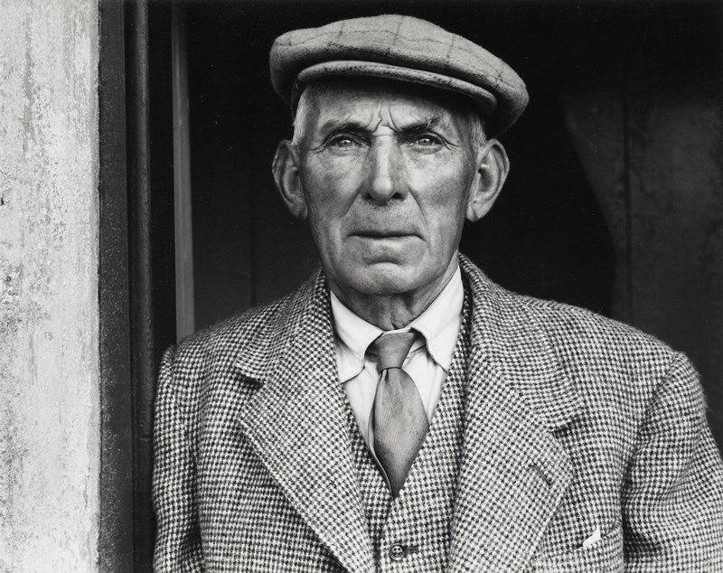bust shot of man in checked suit