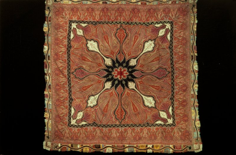 Kussaba, or square shawl, woven in separate pieces and sewed together in patchwork. The border is made of pieces of woolen material of different colors sewed together and embroidered. Maker's signature in corner.