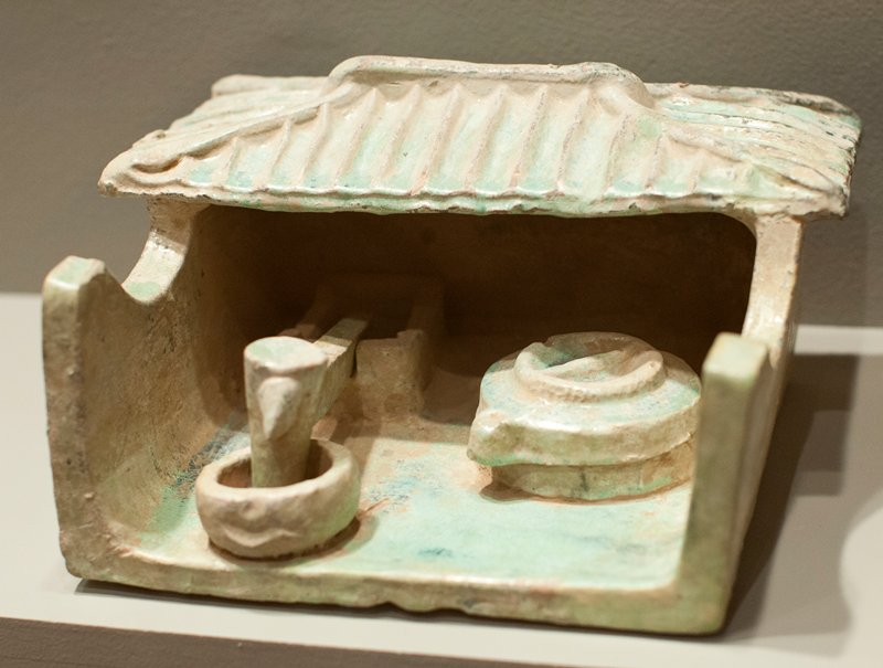 grain mill, low fired earthenware with green lead glaze