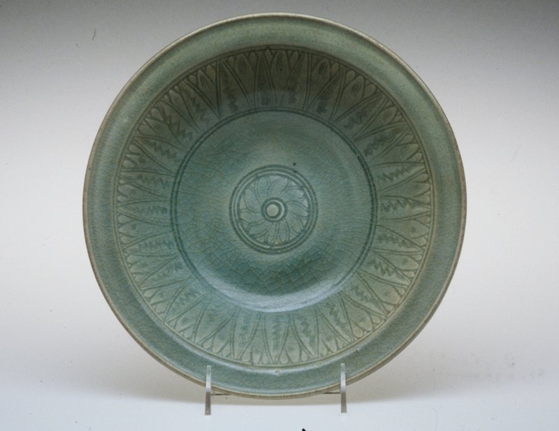 Sawankalok ware Bowl, stoneware with carved floral decor under Celadon glaze.
