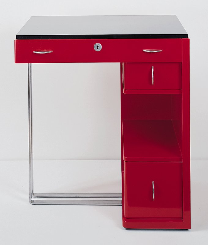 Red with black writing surface; one long drawer beneath writing surface; two drawers on proper left side, either side of shelf. Hardwood with red lacquer finish (restored) and chromium-plated steel, flat band support and brushed chromium crescent ahndles.