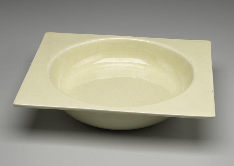 Pale yellow; flat rectangular rim above bowl