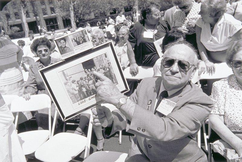 man pointing at photograph