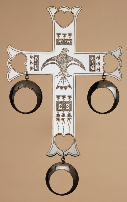 Engraved cross with three pendant rings