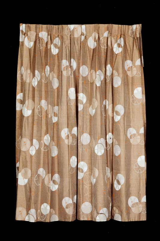 silk and rayon(fortisan), two pieced panels, plain weave, silk screened print, copper-colored background with circle, ovoid and line design elements silk screened in white, tan, orange and gold, fully lined with original pleating and hooks Design 104 from the Taliesin Line, c. 1954