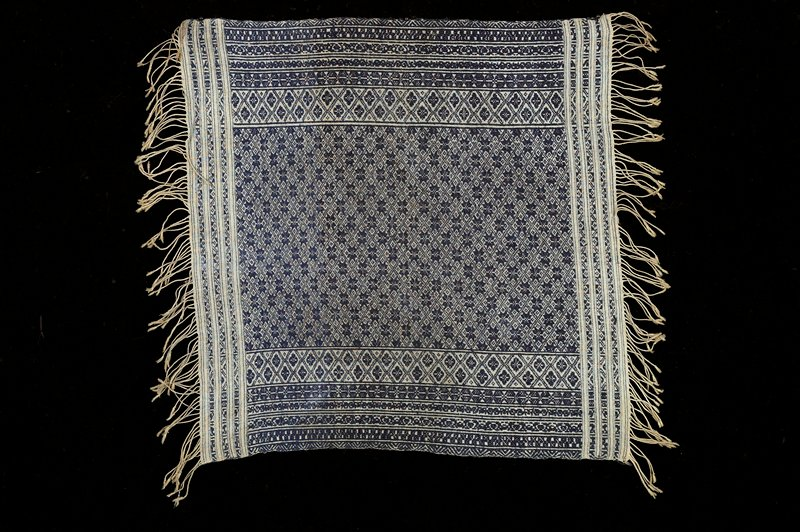 small panel with blue and beige woven decorative pattern