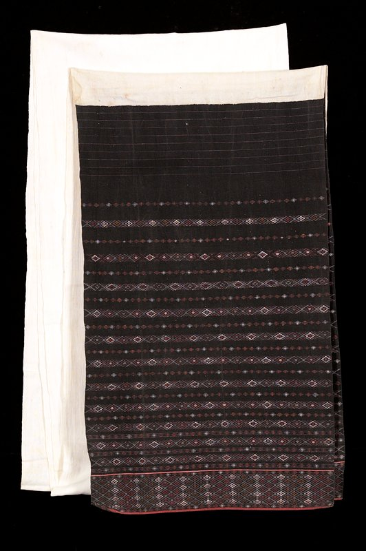 very long panel; plain white center with blue striped ends with patterning in white and red