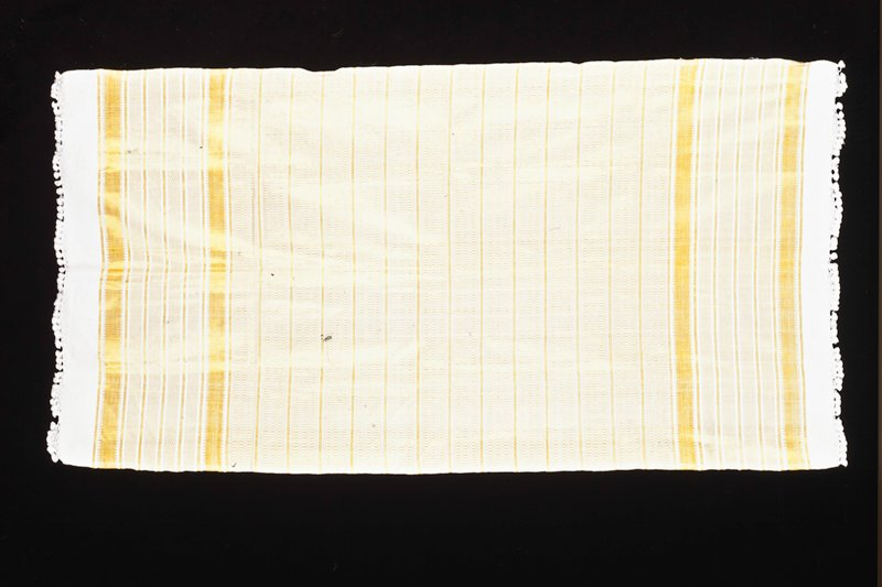 golden yellow supplementary weft patterning on white ground; white tassels on warp ends