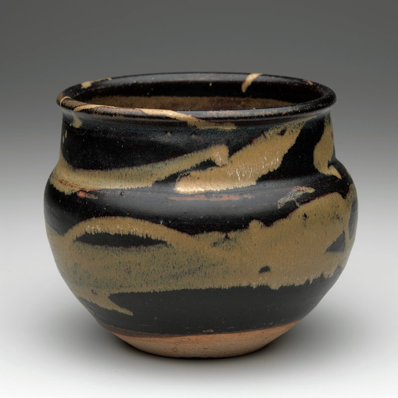 round bodied jar with wide mouth, slightly inverted neck; lighter brown interior with dark brown exterior with tan abstract brush strokes