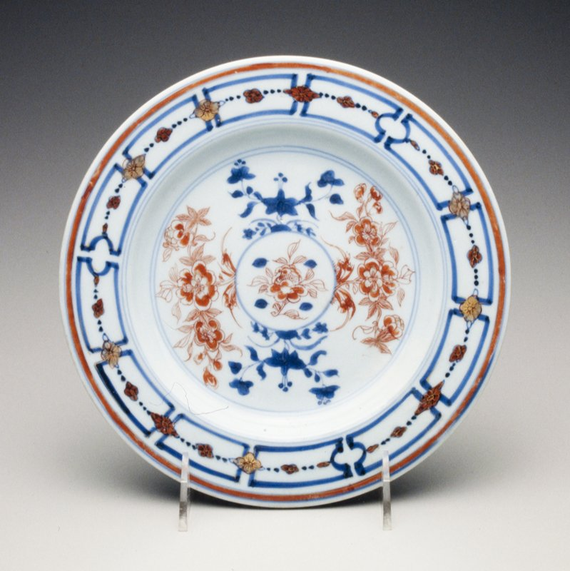 center gilt-heightened iron-red peony sprays; underglaze blue rim with panelled border; divided by gilt and iron-red blossoms