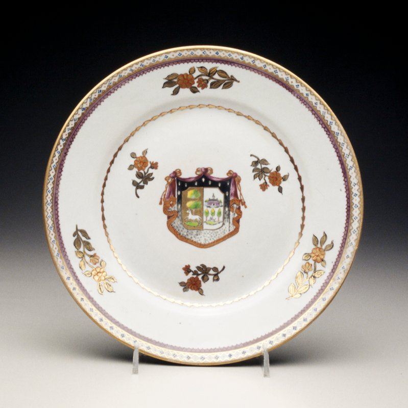 plate with central large coat of arms in colors and gilt, scattered flower sprays rim with gilt wheat-husks within purple, blue and gilt borders