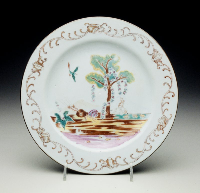 plate decorated with the 'altar of love' or Valentine pattern, two hounds below a tree, and bird flying above emblems of love, iron-red and gilt shell scroll border