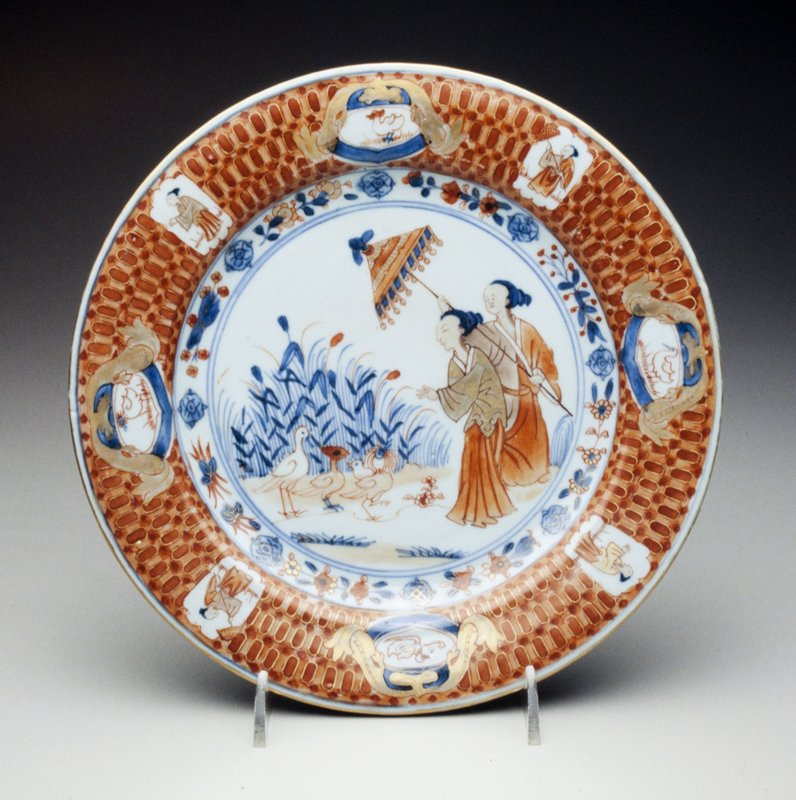plate decorated with underglaze blue; attendant approaching three exotic birds; border with bird and figure cartouche