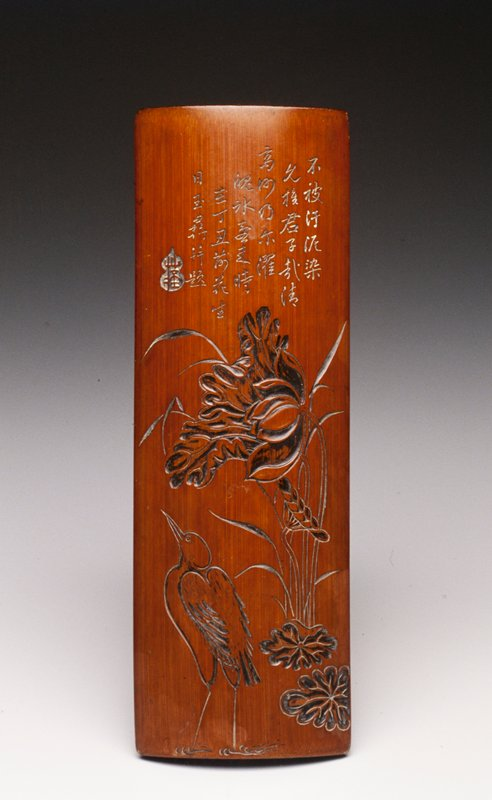 incised and carved with an egret standing in water beneath a lotus and reeds; Oriental Art Gallery Ltd. dealer