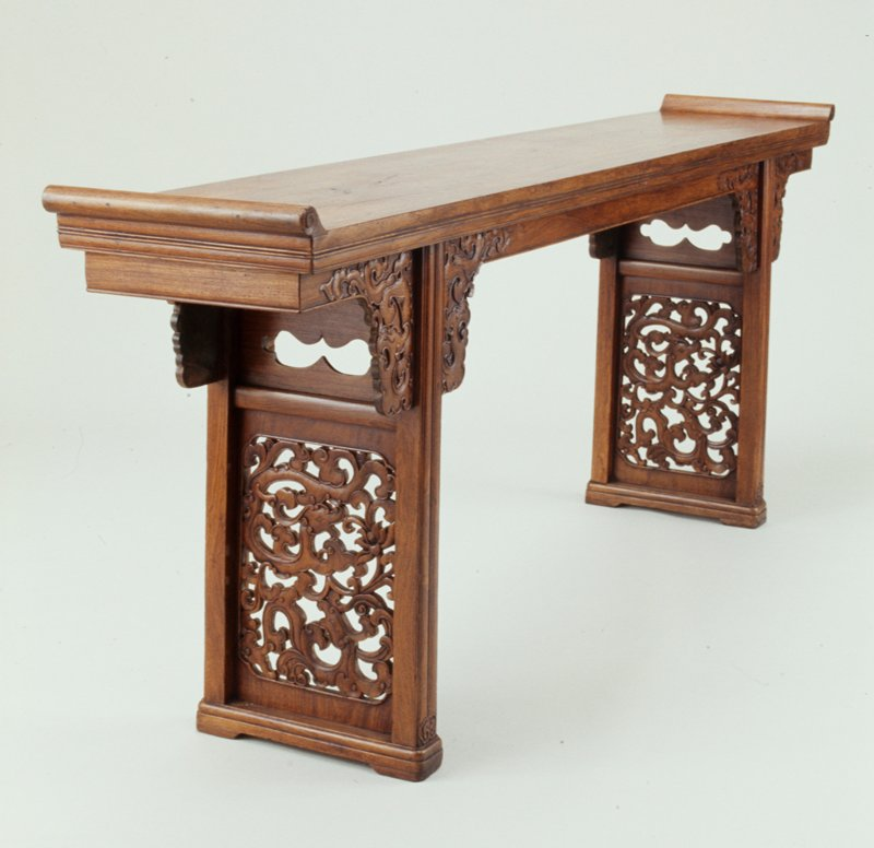 Portable huang hua-li table; deconstructs into nine pieces; scroll ends at table top; open work panes in legs; cloud design sides at leg joint; apron completely around