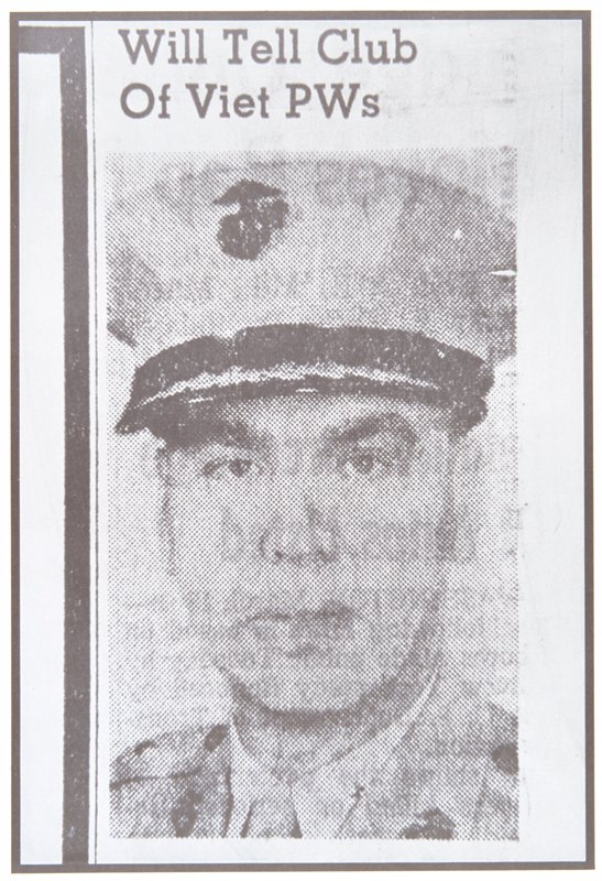 newspaper photograph of a man in military uniform; head and shoulders only