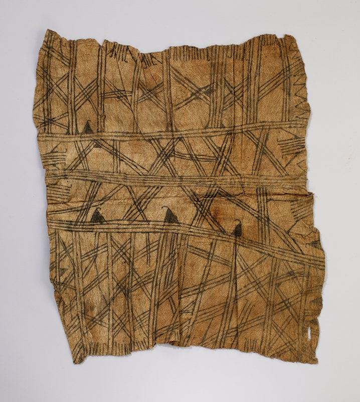 irregular rectangular-shaped tan barkcloth covered decorated with dark brown lines and solid triangles