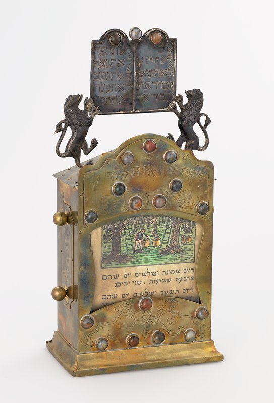 rectangular box with central glass window, with two lions holding up a tablet on top; decorated with polished stones; ink and watercolor on paper inside