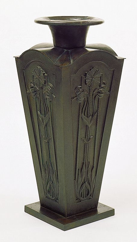 tall flower on each side panel; shoulder consists of four arches