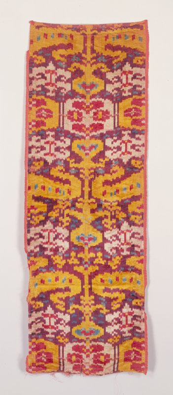 ikat velvet panel in yellow, red, purple and blue; has salvage edges