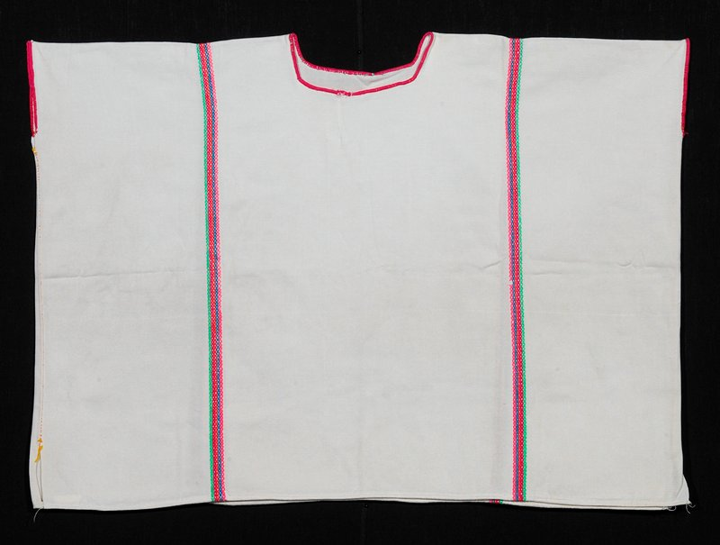 square two-paneled huipil with wide-looped rayon stitch embroidery; bright pink stitching around neck and arm holes; bright colored cross-stitched stripes running down each side and back