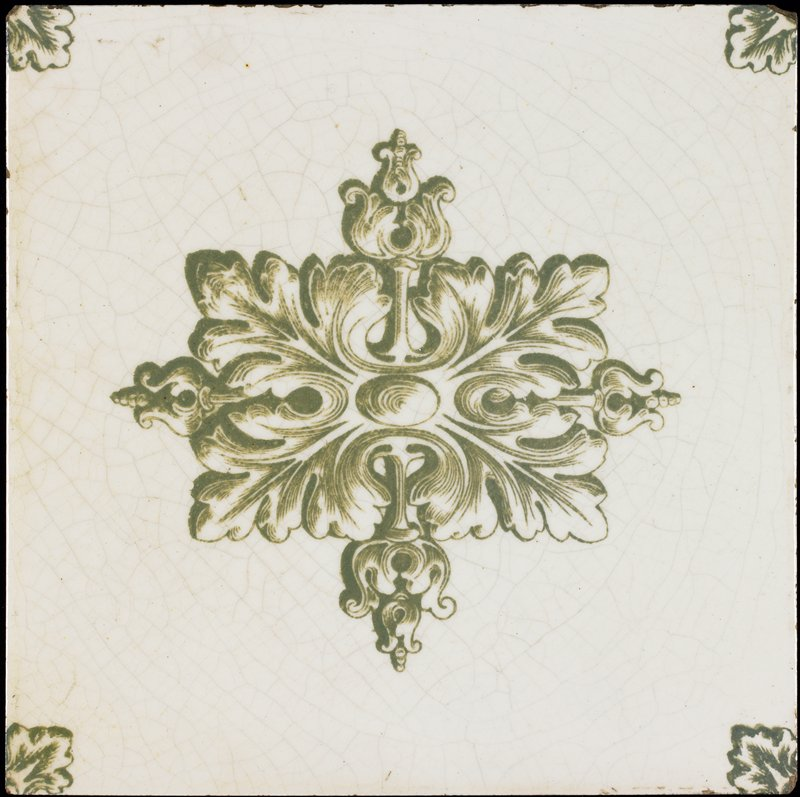 white tile with green transfer decoration of stylized central leaf with leaves at corners, in green