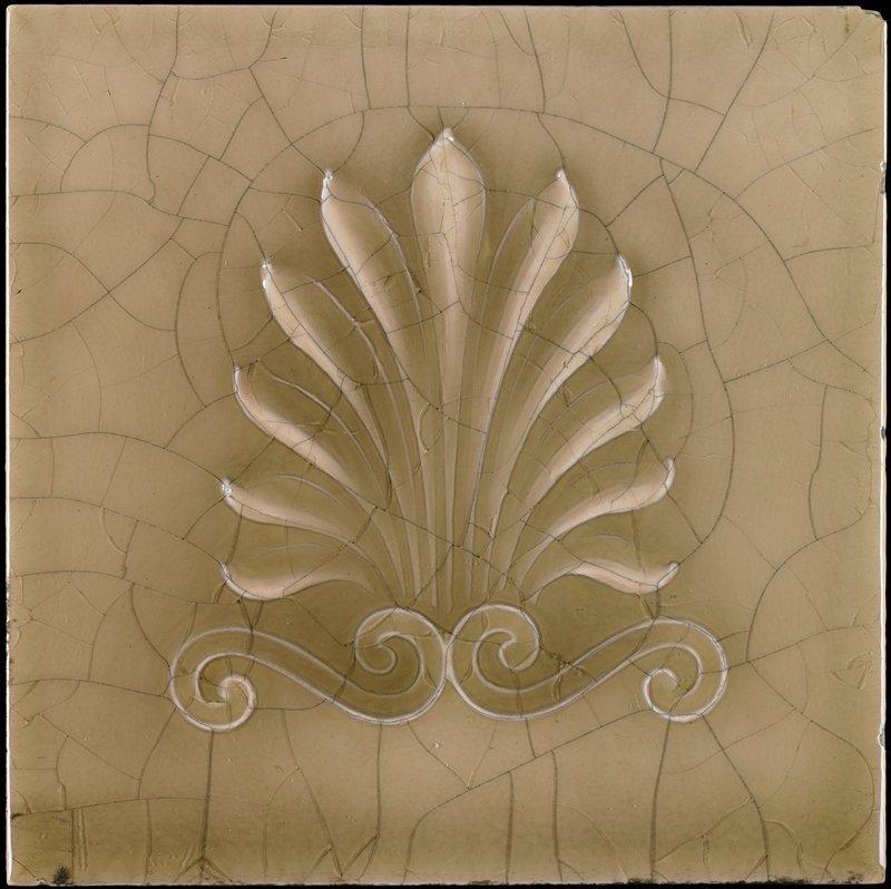 muolded decoration of foliate spray and 2 scrolls; neutral beige glaze