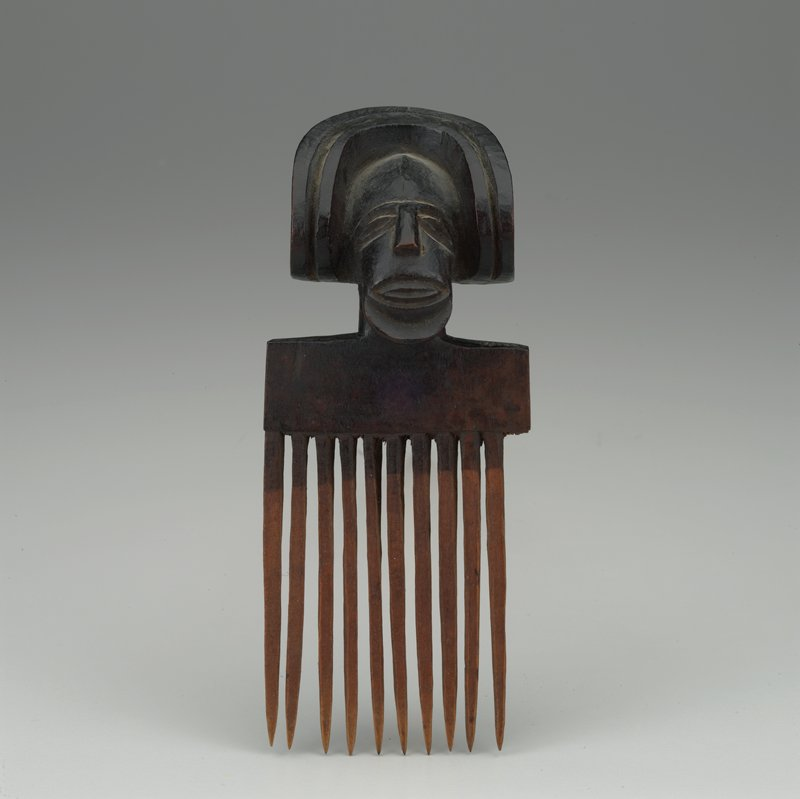 comb topped with head with elongated face and U-shaped hairstyle