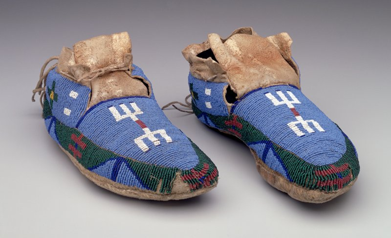 rawhide soles; tanned uppers; beaded overall on tops with blues, green, red, yellow and white geometric designs