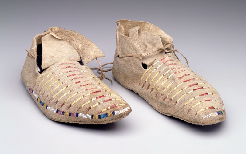 rawhide soles (from parfleche case); tanned hide uppers; quill stripes across vamps and on ties; beaded bands around outer edges and on heels