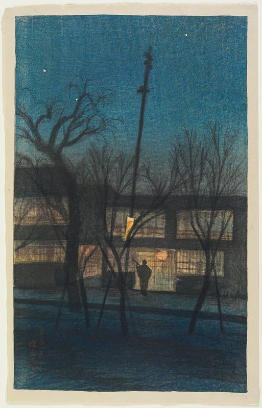 landscape; street scene at night with figure at center; illuminated building behind figure; bare trees