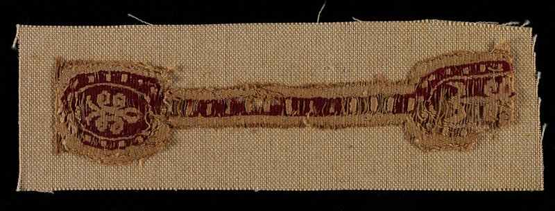 barbell-shaped fragment; red and tan; organic and geometric designs