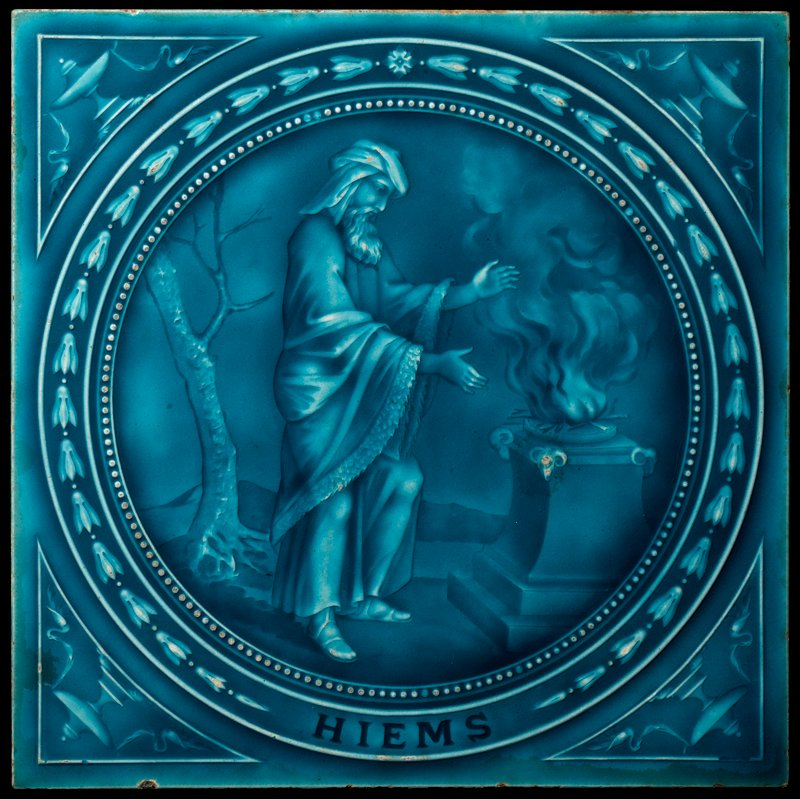 "blue glaze; tondo containing scene of bearded man wearing a turban and sandals before a fire on a pedestal; urns with ribbons in corners; ""HIEMS"" at center bottom"