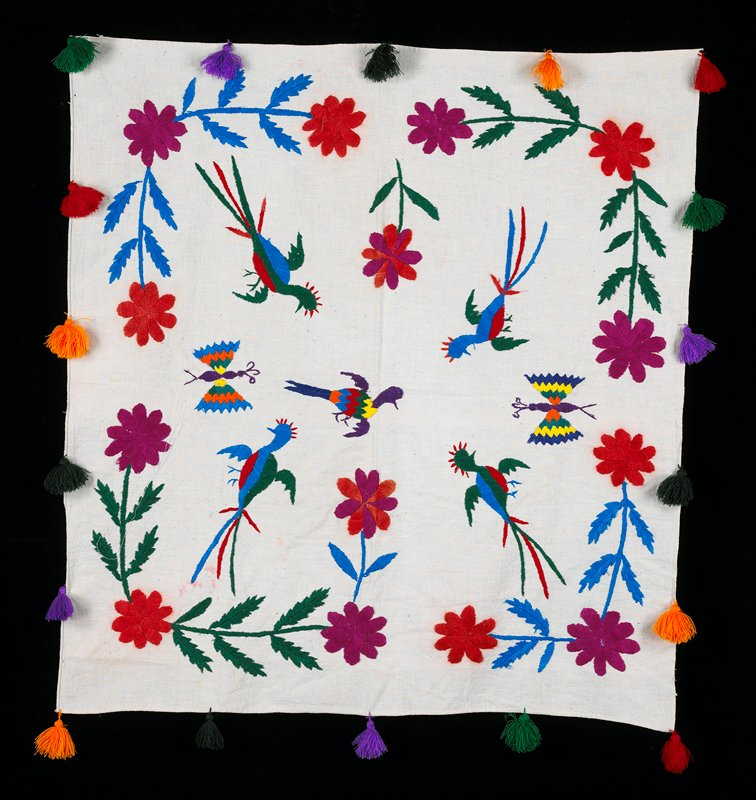 Hand embroidered on white background; multicolored flowers, butterflies and birds; tassles around the four selvedges.