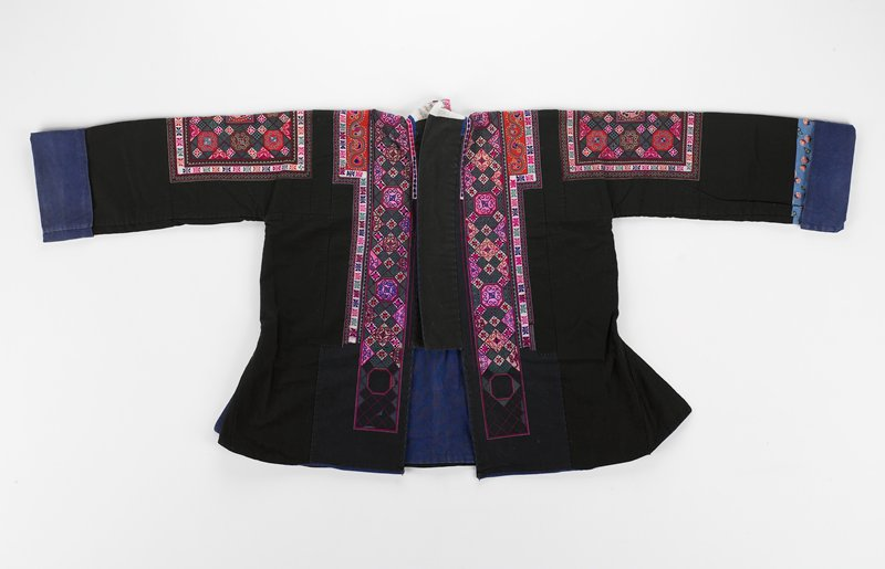 short black jacket with blue lining; u-shaped embroidered panel on back in greens, pinks and blue; embroidered panels on upper arms and on either side of front opening