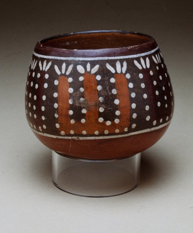 Cup, with a painted band of stylized plants edged with polka dots. Solid brick-colored base. Mouth nicked.