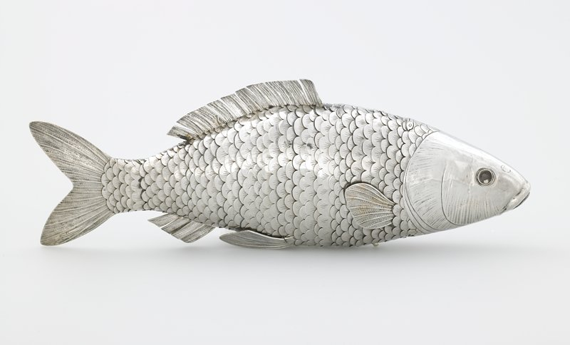 fish shaped; constructed with hinges so body is flexible; head is hinged; mouth hinged and lower lip has holes; glass eyes; has plexi mount