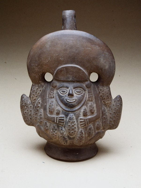 black pot representing Corn God, surrounded by ears of corn; cracked