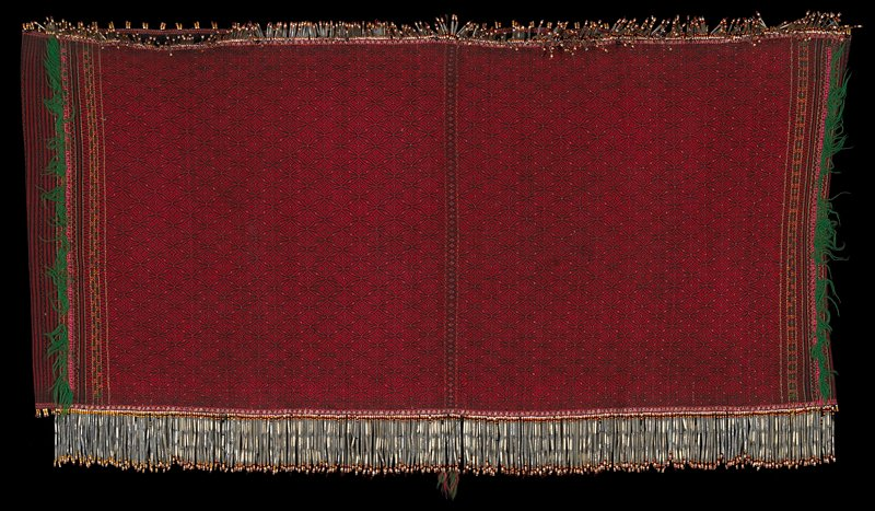 Red and black striped and motifs; green fringe; one edge