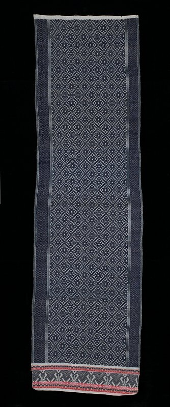 """Ecru background with blue patterning, diamond motifs; at one end 6"""" section (blue bird motif), red and orange stripes"""