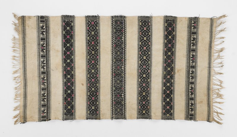 cream ground; nine woven bands in black, red, green, yellow and salmon; pairs of birds and geometric design stripes; cream fringe