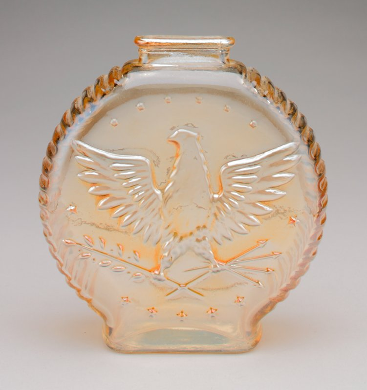 transparent amber glass; moulded in thick coin shape with ribbed sides; front has eagle with branch and arrows in claws, surrounded by stars