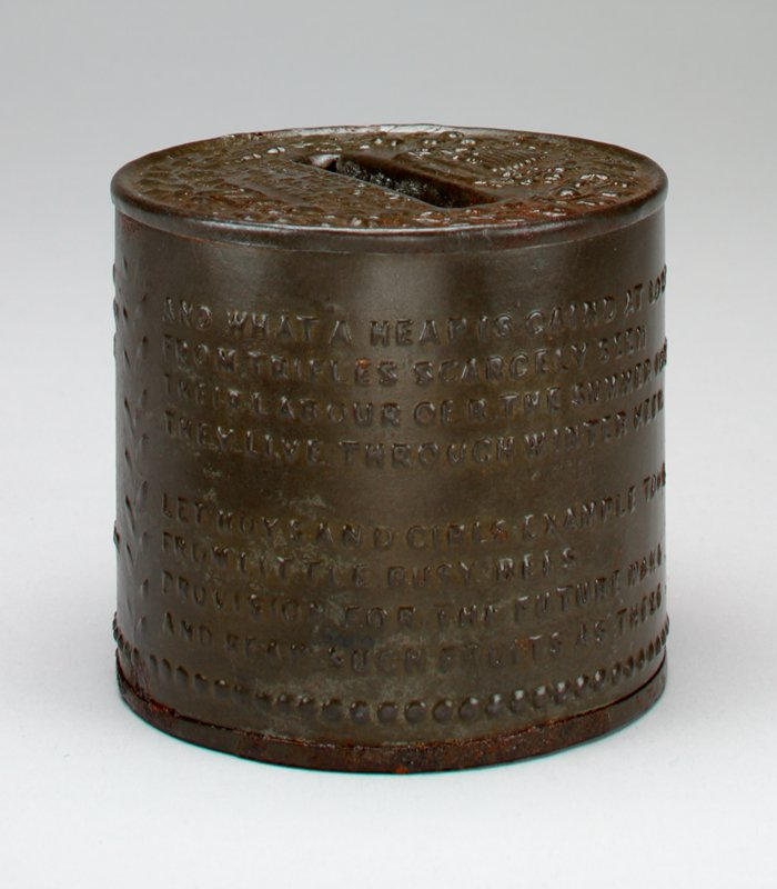 squat cylindrical bank; body has raised poem; top has floral wreath and text in relief; khaki green patina