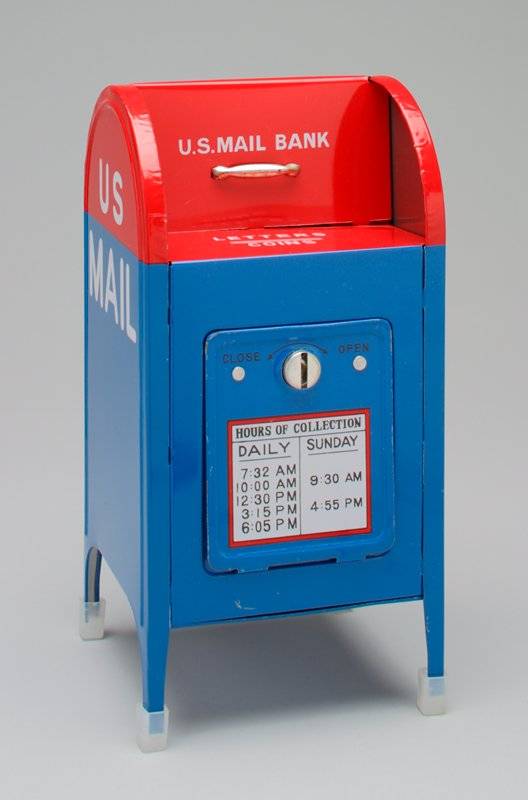 "mailbox-shaped bank in red and blue labeled ""U.S. Mail""; plastic protectors on all 4 legs with key taped to top"