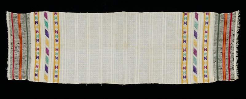 Woven panel, white background; pairs of warp stripes are divided by high-relief squares; four sections of loos warp threads; fastened by three weft woven stripes; silk brocade decorations in geometric patterns and stripes in gold, purple, magenta and green.
