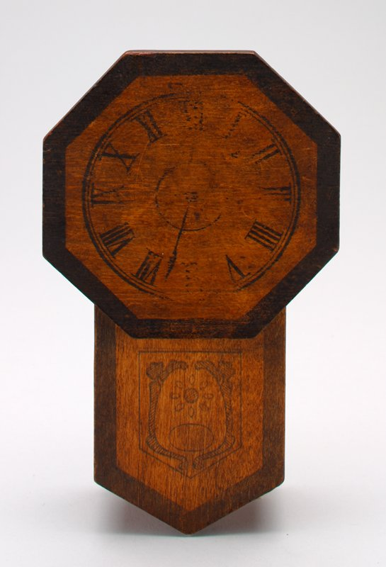 "wooden wall clock in the ""Regulator"" style; printed representation of window at lower half to see pendulum; octagonal clock face printed at top half; coin slot on top; hole in back to hang bank on wall"