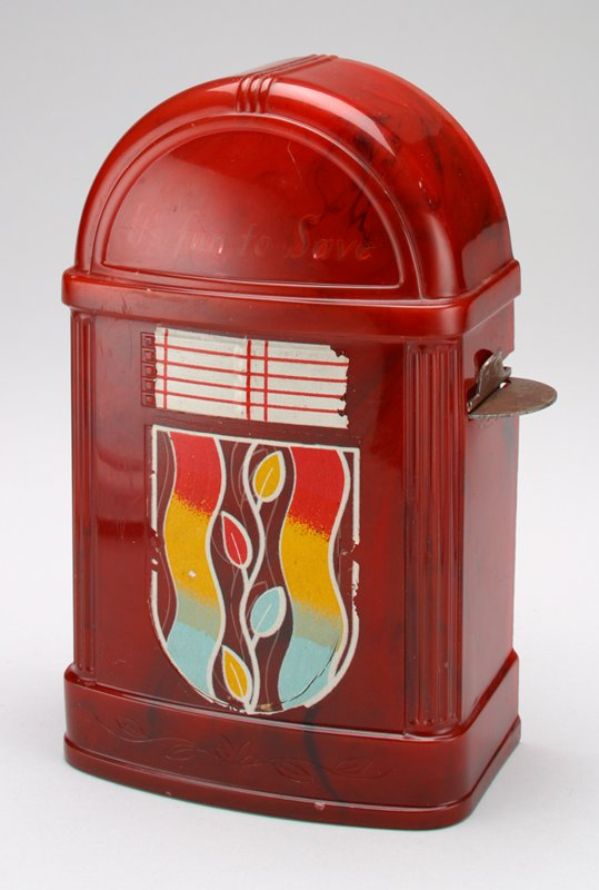dark red jukebox with white, red, yellow and blue floral painted design on front; metal slot for coins, PL side