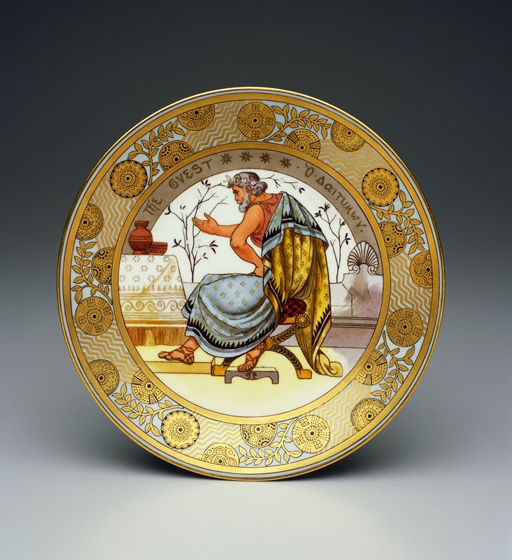Rim decorated with gold and black with zigzags, circles enclosing geometric designs and foliage; multicolored interior decorated with man wearing flowing togalike garment with sets of 4 circles and black trim sitting on a stool gesturing with PR hand and PL hand on hip; Greco-Roman interior